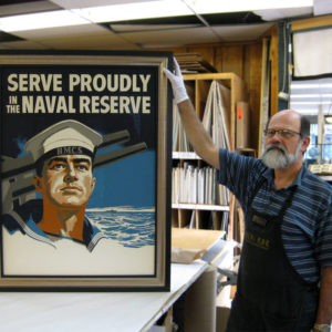 We framed this uplifting vintage Navy Recruitment poster using 2 frames: a cap frame from Roma Moulding's Tempo collection, and black inner frame from Larson-Juhl's custom frames' Brownstone collection. Framed at Kingston Frameworks.