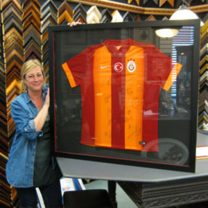 Our client brought in a European Football jersey, purchased abroad after a game and signed by the team. Framed by Kingston Frameworks.